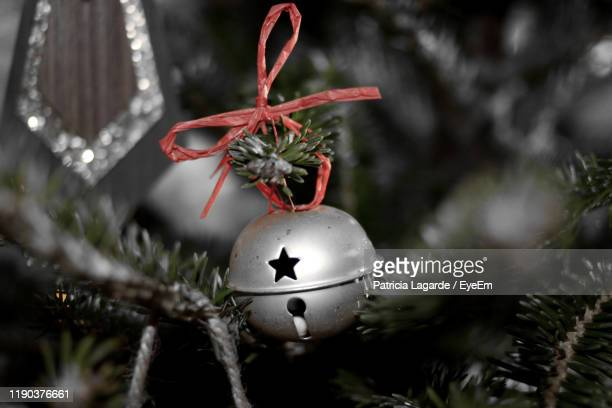 close-up of christmas decoration hanging on tree - lagarde stock pictures, royalty-free photos & images