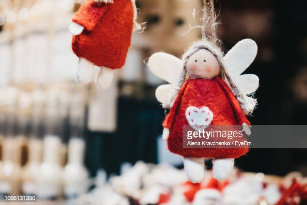 close-up of christmas decoration hanging outdoors - human representation stock pictures, royalty-free photos & images