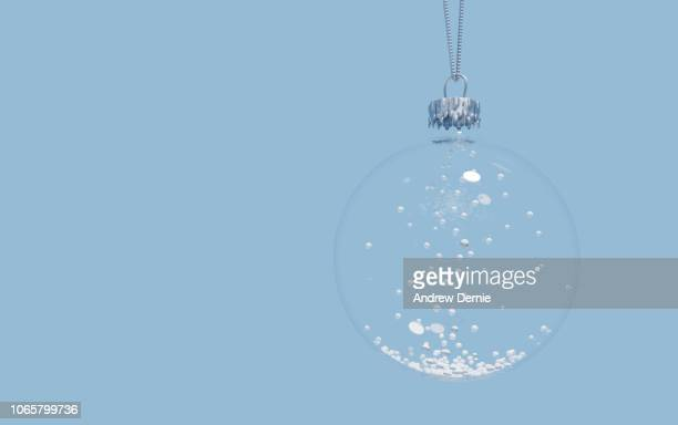 close-up of christmas decoration hanging over blue background - andrew dernie photos et images de collection