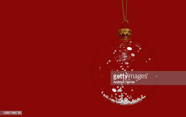 Close-Up Of Christmas Decoration Hanging Over Red Background