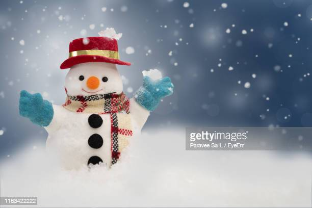 close-up of christmas decoration on snow during winter - snowman stock pictures, royalty-free photos & images