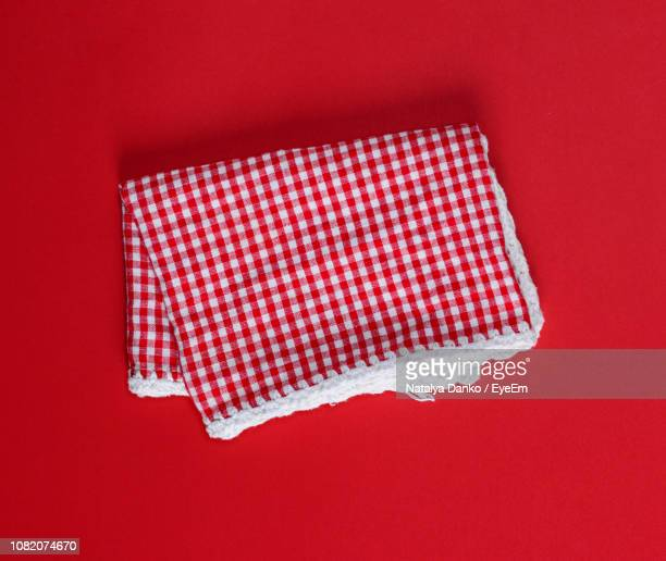 close-up of christmas decoration with bead on red background - dish towel stock pictures, royalty-free photos & images
