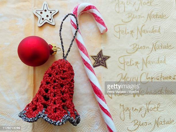 close-up of christmas decoration with text on table - petra bell stock-fotos und bilder