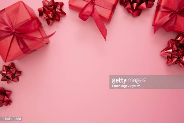 close-up of christmas decorations against pink background - gift stock pictures, royalty-free photos & images