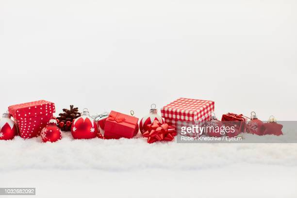 close-up of christmas decorations against white background - christmas gifts stock photos and pictures