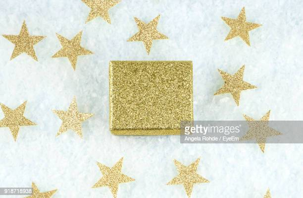 close-up of christmas decorations against white background - gold star stock pictures, royalty-free photos & images