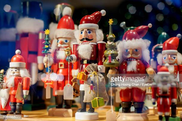 close-up of christmas decorations for sale - santa close up stock pictures, royalty-free photos & images