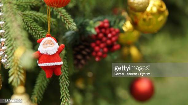 close-up of christmas decorations hanging on tree - santa close up stock pictures, royalty-free photos & images