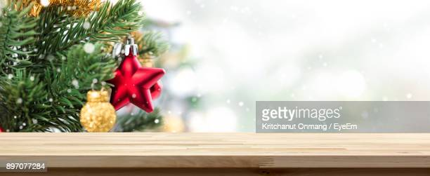 close-up of christmas decorations nu table - christmas table stock pictures, royalty-free photos & images