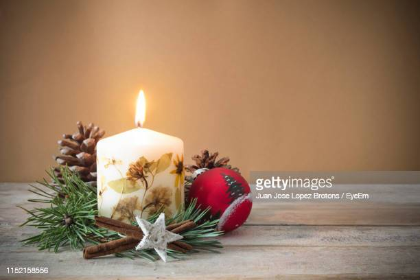 close-up of christmas decorations on table - christmas decore candle stock pictures, royalty-free photos & images