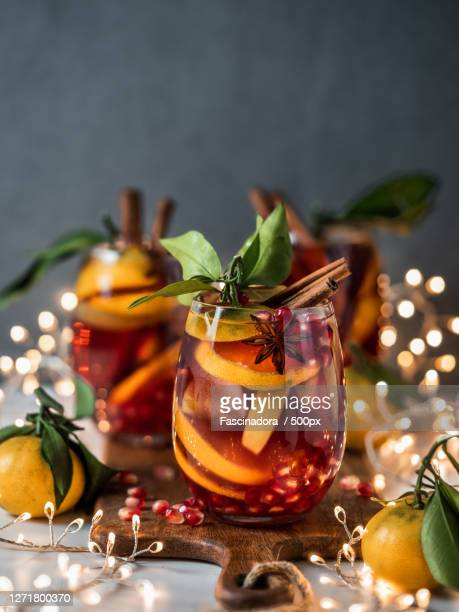 close-up of christmas decorations on table - sangria stock pictures, royalty-free photos & images