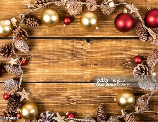 Close-Up Of Christmas Decorations On Wooden Table