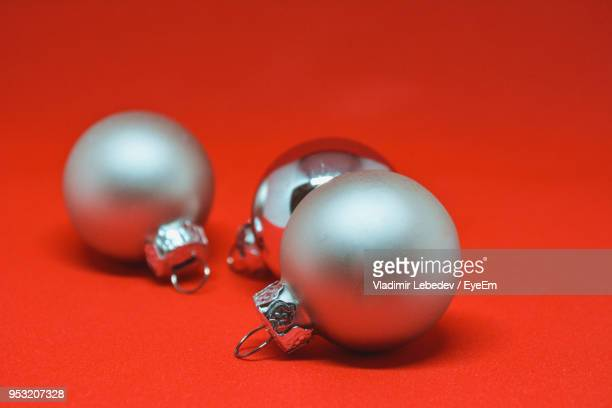 Close-Up Of Christmas Decorations Over Red Background