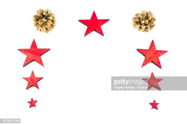close-up of christmas decorations over white background - angela rohde stock-fotos und bilder