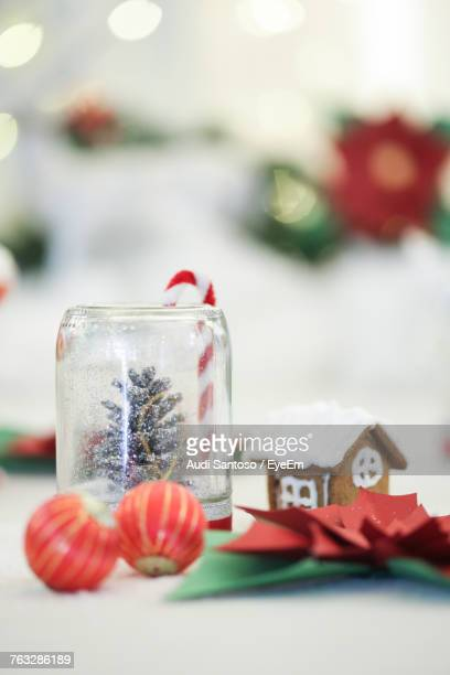 Close-Up Of Christmas Decorations With Food On Table