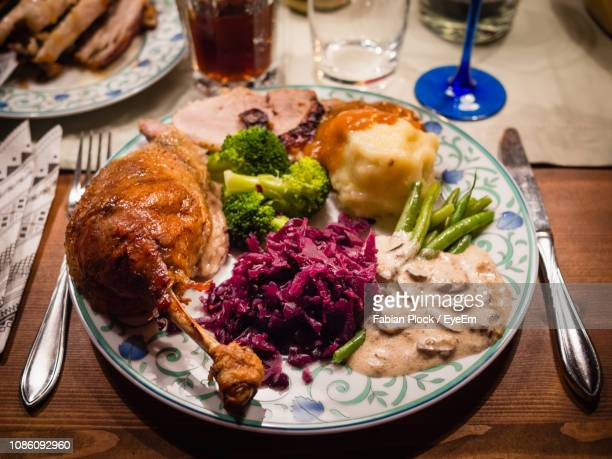 close-up of christmas food served on table - thanksgiving plate of food stock pictures, royalty-free photos & images