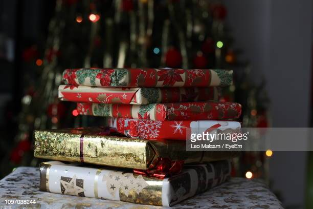 Close-Up Of Christmas Gifts On Table