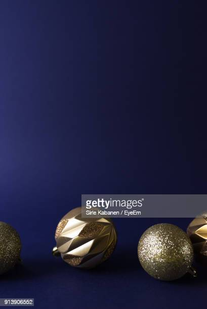 close-up of christmas ornaments against blue background - christmas still life stock pictures, royalty-free photos & images