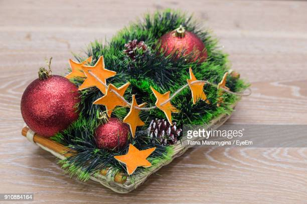 Close-Up Of Christmas Ornaments In Basket