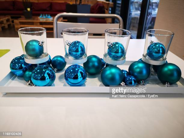close-up of christmas ornaments on table - casapiccola stock-fotos und bilder