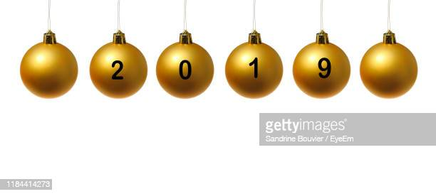 close-up of christmas ornaments with numbers hanging against white background - 2019 stock pictures, royalty-free photos & images