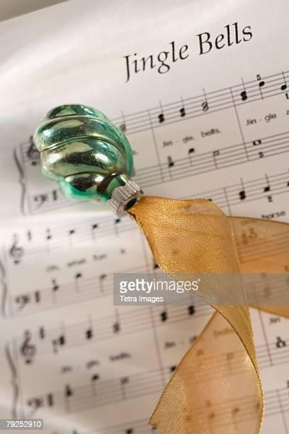 Closeup of Christmas ornanament and music