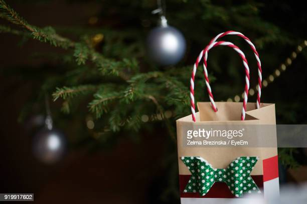 Close-Up Of Christmas Present By Tree