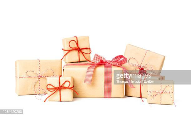 close-up of christmas presents against white background - gifts stock pictures, royalty-free photos & images