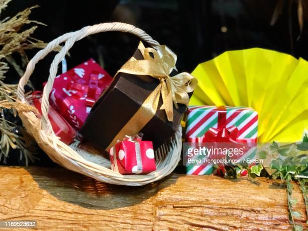 close-up of christmas presents - basket stock pictures, royalty-free photos & images