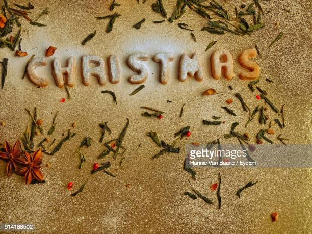 Close-Up Of Christmas Text On Marble