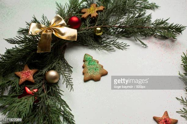 close-up of christmas tree against wall - 名作 発祥の地 ストックフォトと画像