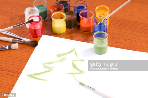 Close-Up Of Christmas Tree Painting On Paper At Table