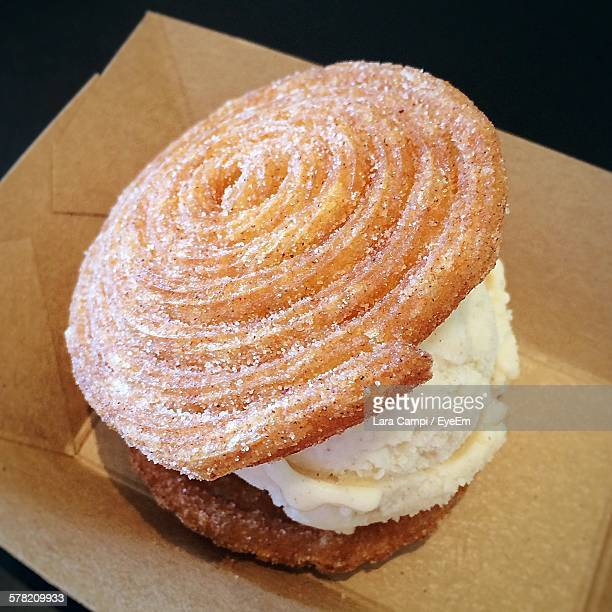 close-up of churro ice cream sandwich on container - churro stock photos and pictures