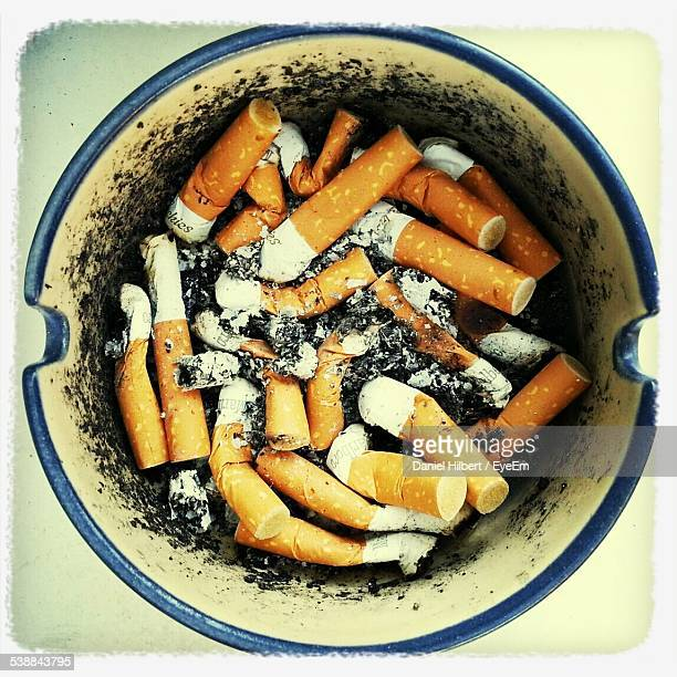 Close-Up Of Cigarette Butts In Ashtray