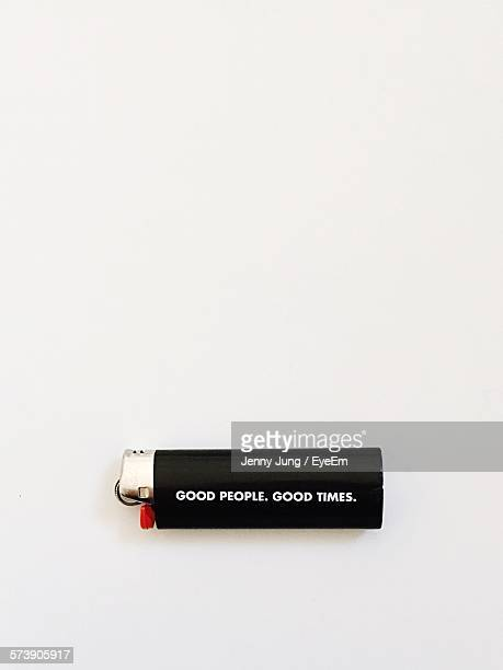 Close-Up Of Cigarette Lighter Against White Background