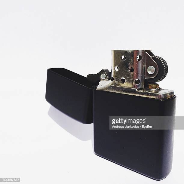 close-up of cigarette lighter on white background - cigarette lighter stock pictures, royalty-free photos & images