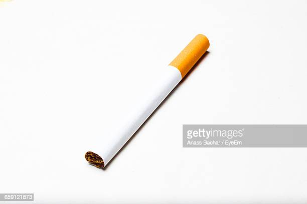 Close-Up Of Cigarette On White Background