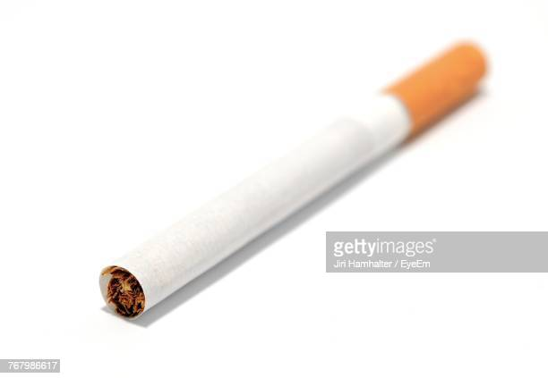 Close-Up Of Cigarette Over White Background