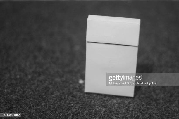 close-up of cigarette pack on rug - cigarette pack stock pictures, royalty-free photos & images