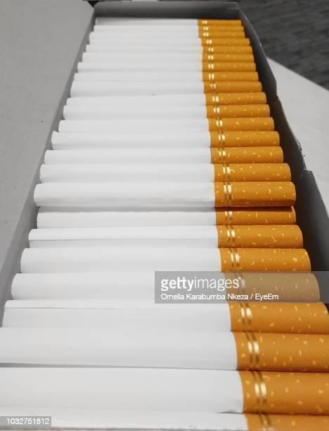 close-up of cigarettes in box - cigarette packet stock pictures, royalty-free photos & images