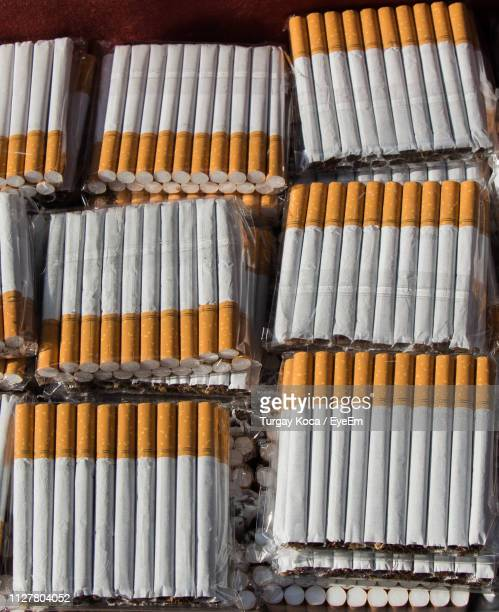 close-up of cigarettes in row - cigarette packet stock pictures, royalty-free photos & images