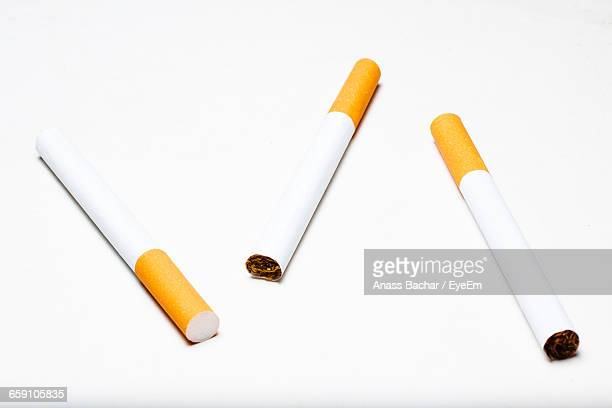 Close-Up Of Cigarettes On White Background