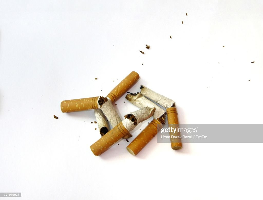 Close-Up Of Cigarettes Over White Background : Stock Photo