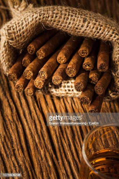 close-up of cigars in sack on table - 葉巻 ストックフォトと画像