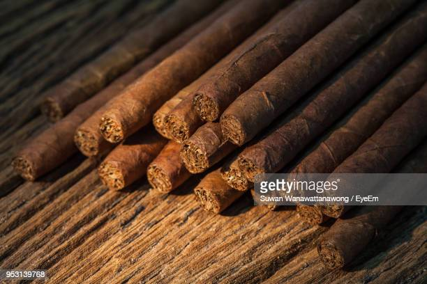 close-up of cigars on wooden table - 葉巻 ストックフォトと画像