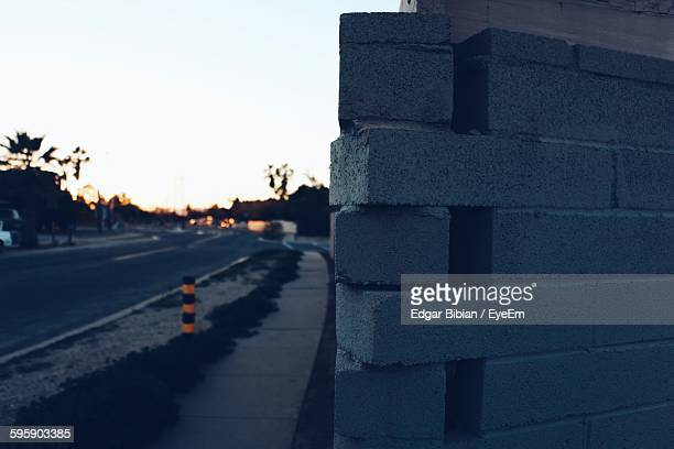Close-Up Of Cinder Block Wall By Road