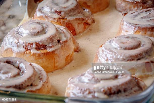 Close-Up Of Cinnamon Buns In Container