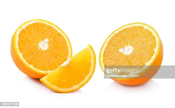 close-up of citrus fruit over white background - naranja fotografías e imágenes de stock