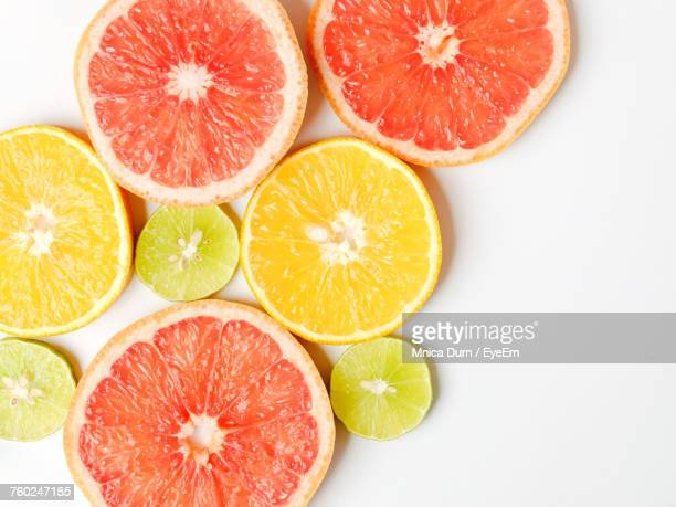 close-up of citrus fruit slices on table - grapefruit red stock pictures, royalty-free photos & images