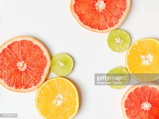close-up of citrus fruit slices on table - citrus fruit stock pictures, royalty-free photos & images